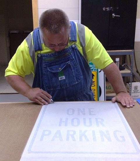 Man Drawing a Road Sign