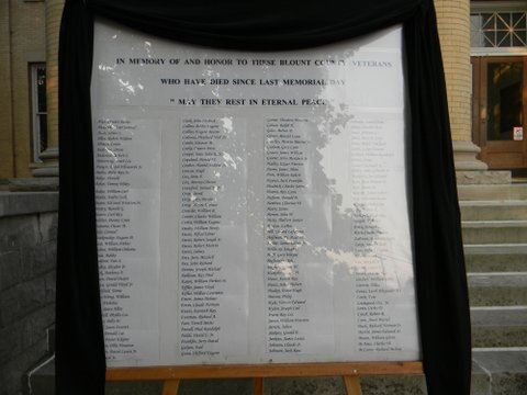 Image of framed list of war dead, with veil