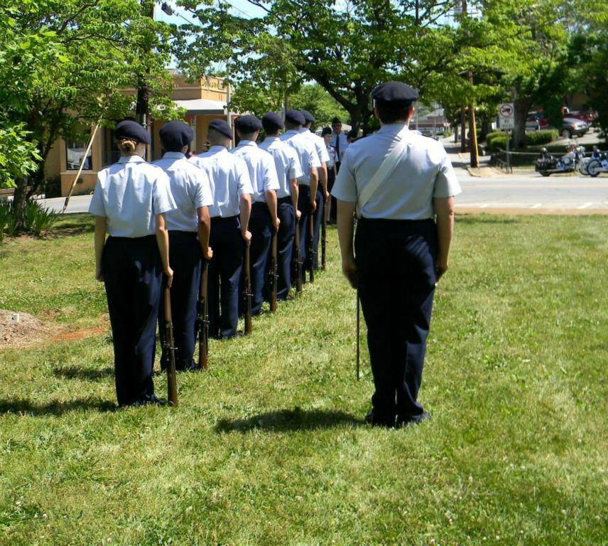Servicemembers in line, standing at attention