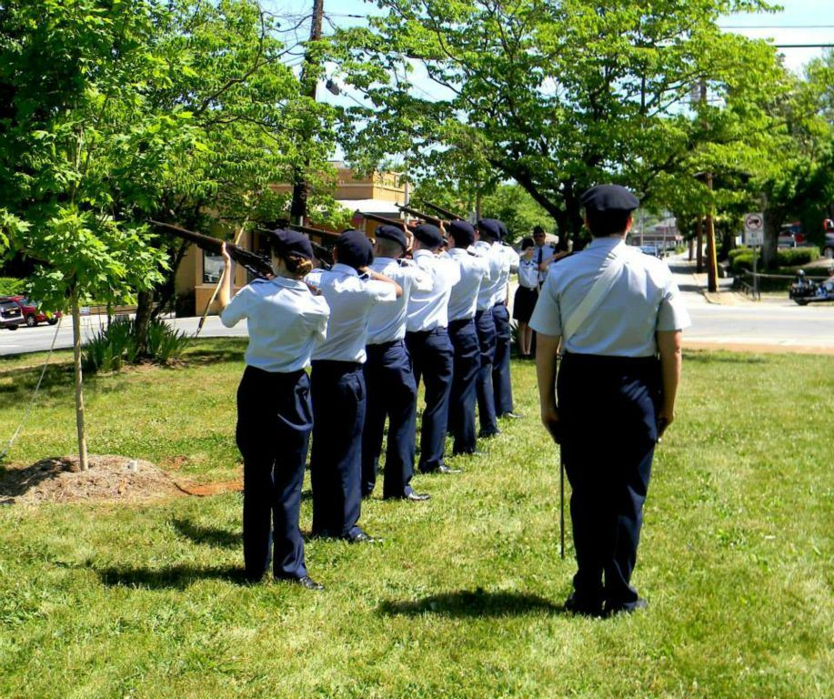 Line of servicemembers standing at attention