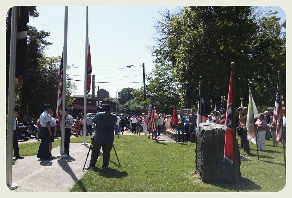 Image of lawn, flags, and memorial at Court House
