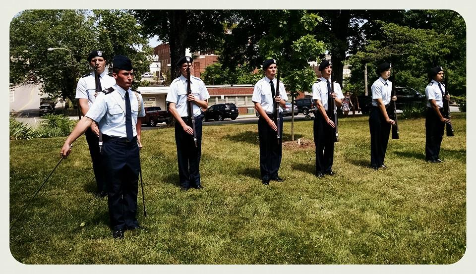 Cadets with firearms, at attention