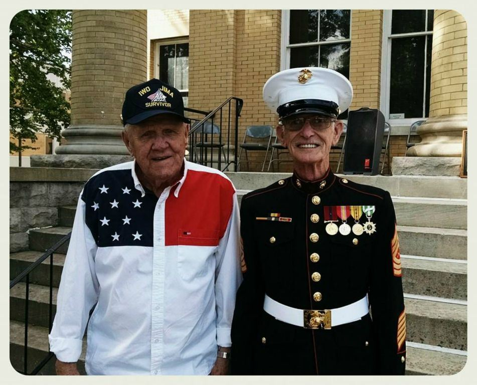 Two veterans, one in full Marine regalia, standing in front of Court House steps