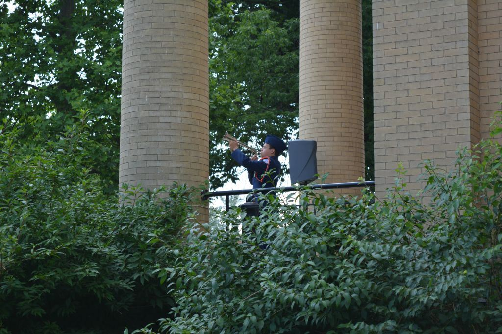 Image from below of trumpeteer on balcony