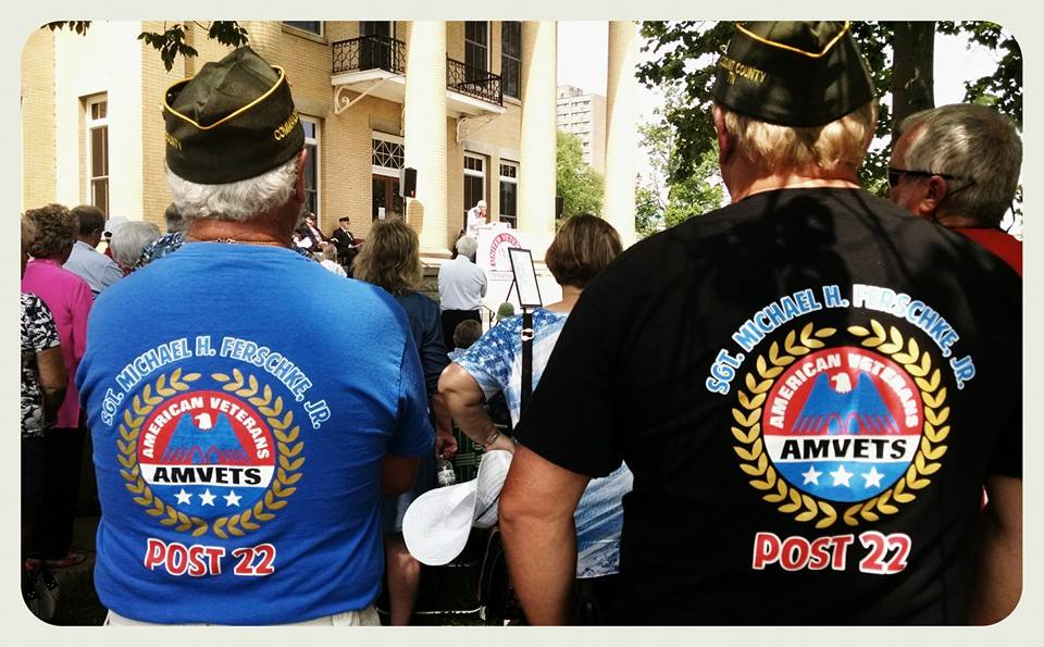 Two men with AMVETS Post 22 shirts, from behind