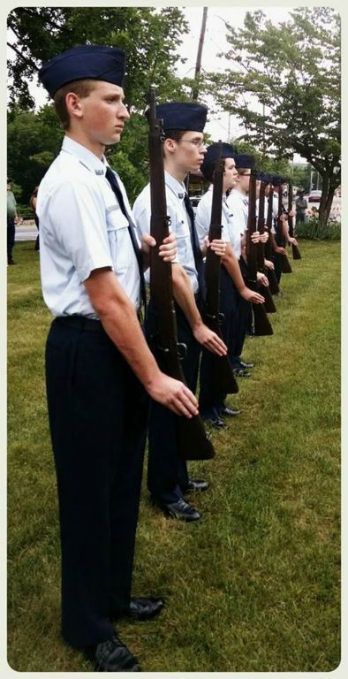 Cadets in a line with firearms, at attention