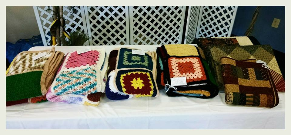 Image of quilts and blankets on display on a table
