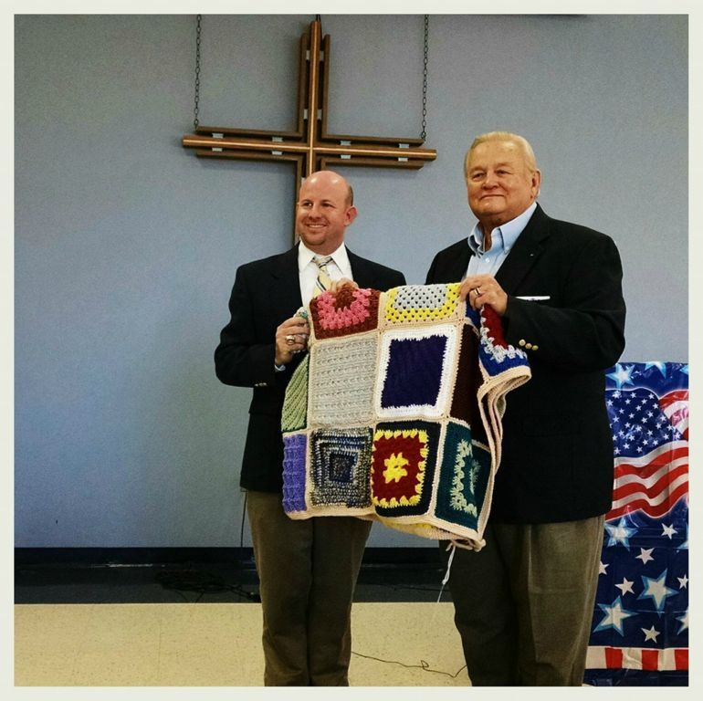 Presentation of knitted blanket to veteran