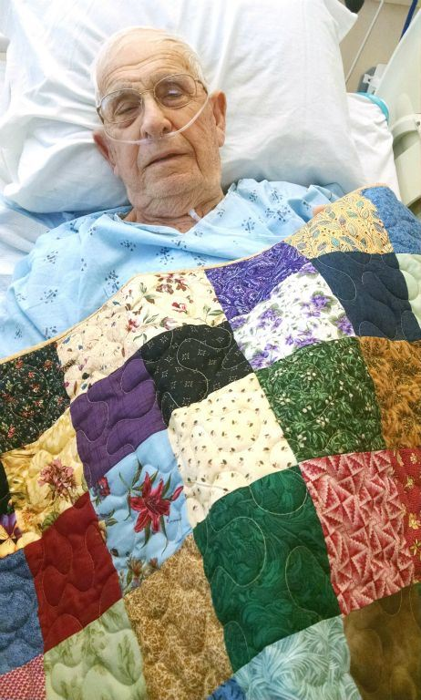 Veteran in hospital bed with blanket covering him