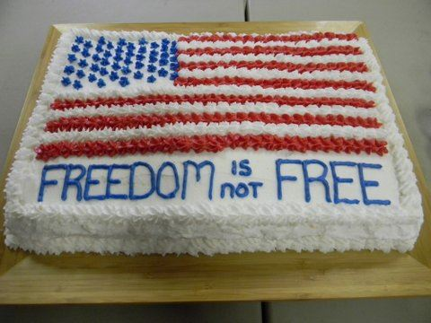 Rectangular sheet cake with American flag and text, Freedom is not Free