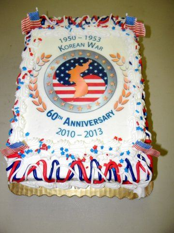 Rectangular sheet cake, with Korean War emblem at center, laurels, red white and blue frosting, and dates of war