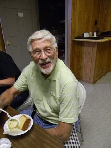 Man sitting, smiling, with cake