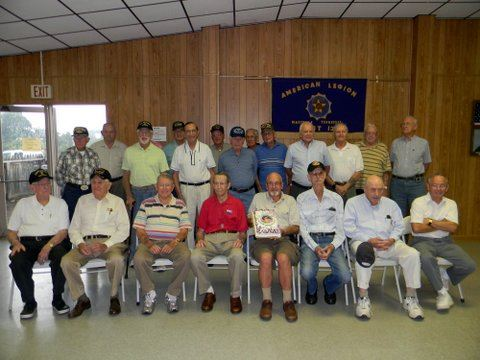 Veterans sitting and standing in a group