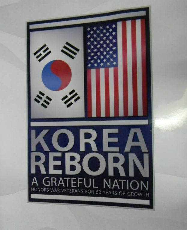 "Image of poster with Korean and American flags, with text "" Korean Reborn: A Grateful Nation"""