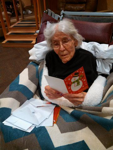 Woman in chair reading a snowman card