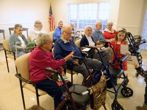 Image of veterans sitting in a group, receiving cards