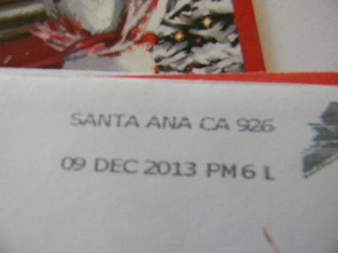 Image of postmark from Santa Ana, California, December 9, 2013