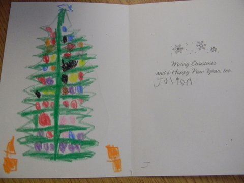 Interior of card, left side has child's drawing of Christmas tree