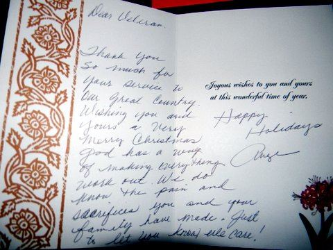 Image of the interior of a card with cursive handwriting, thanks a veteran for their service and happy holidays.