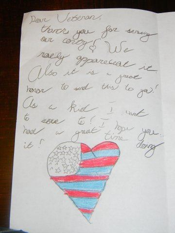 Image of interior of card, thanking veteran for their service with drawing of a heart with American flag pattern
