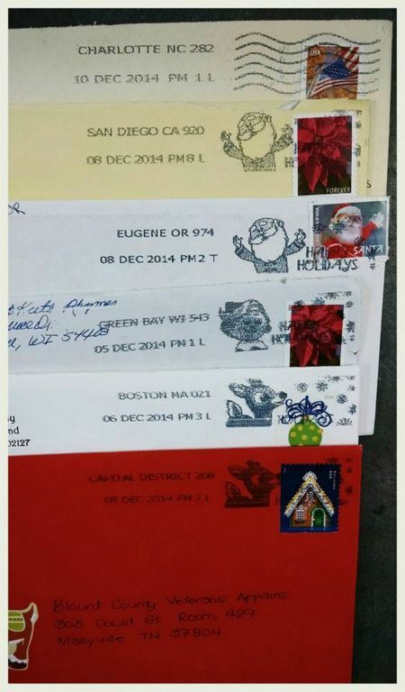 image of six cards stacked on top of each other each with a differnt postmark two sitting veterans - Christmas Cards For Veterans