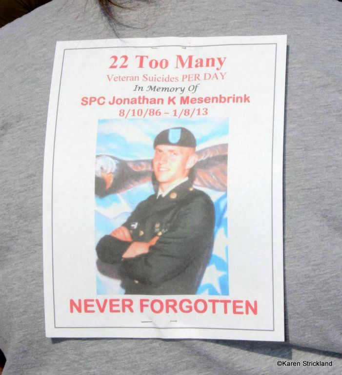 Image of printed sign, 22 Too Many Veteran Suicides PER DAY In Memory of SPC Jonathan K Mesenbrink