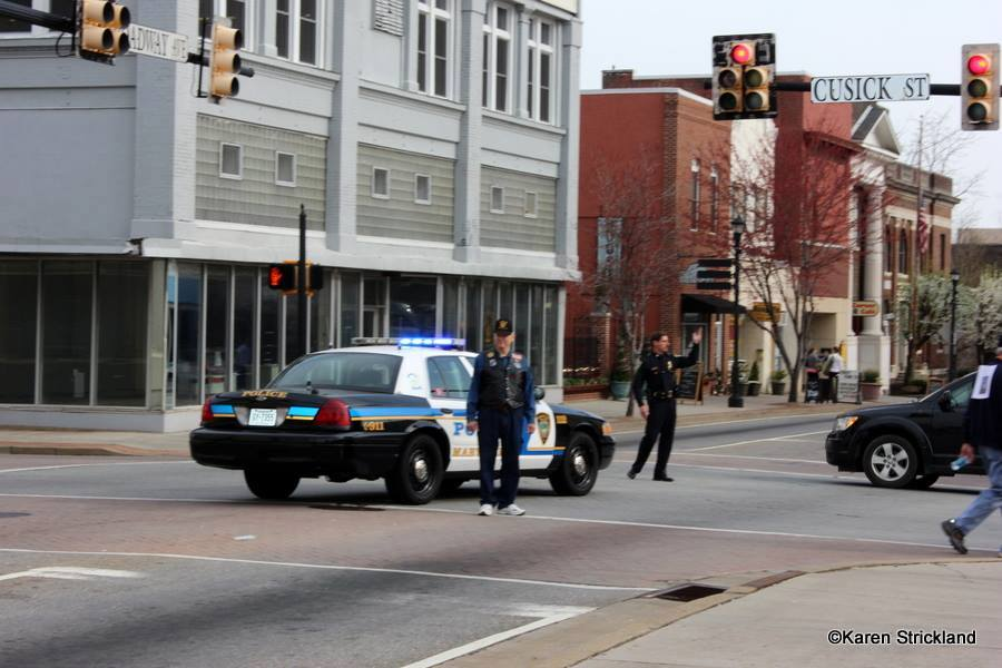 Police cruise blocks cross street for walkers
