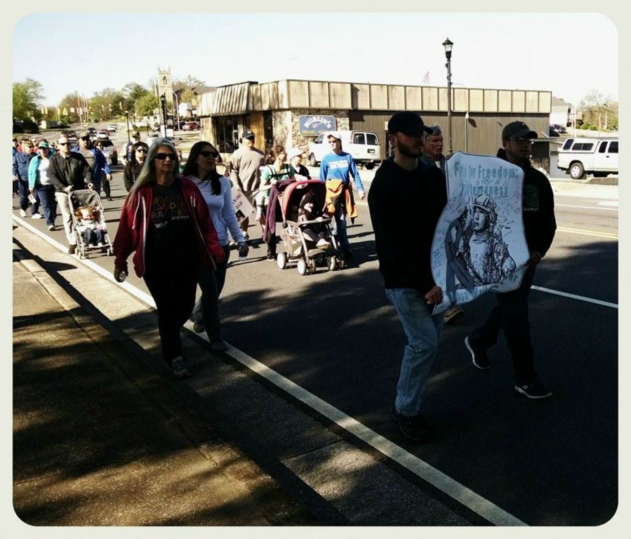 Image of line of walkers, with front two people holding Frettin' for Freedom sign