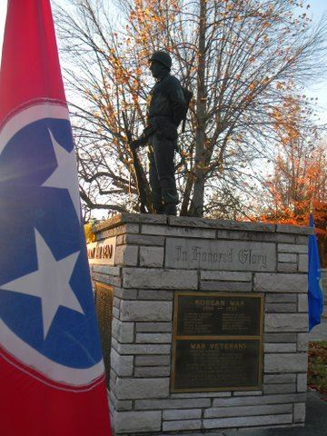Image of  flag with the Blount County War Dead memorial soldier statue in background