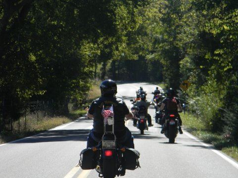 Image taken from motorcycle of motorcycles in front on road